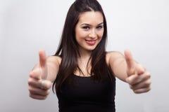 Leuke gelukkige of vrouw die richt toont stock afbeeldingen