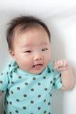 Leuke het gezichts dichte omhooggaand van de babyglimlach Royalty-vrije Stock Afbeelding