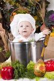 Leuke jongen in een kokpan Royalty-vrije Stock Afbeelding