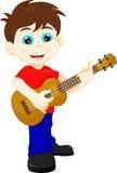 Leuke jongen het spelen gitaar Royalty-vrije Stock Foto's