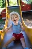 Leuke jongen op een dia Stock Foto's