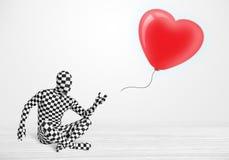 Leuke kerel in het kostuum die van het morpsuitlichaam een ballon gevormd hart bekijken royalty-vrije stock fotografie