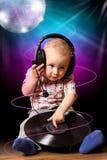 Leuke kindbaby DJ in disco Royalty-vrije Stock Foto's