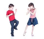 Leuke kinderen die karate spelen Stock Foto