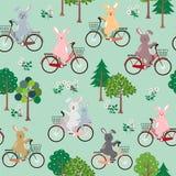 Leuke konijnen de troep met fiets gelukkig in het tuin naadloze patroon voor jong geitjeproduct, manier, stof, textiel, druk of b vector illustratie