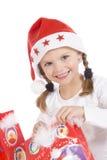 Leuke meisje en Kerstmisgiften Stock Afbeelding