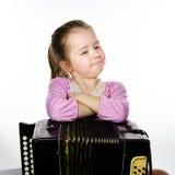 Leuke meisje het spelen harmonika, het concept van het muziekonderwijs royalty-vrije stock foto