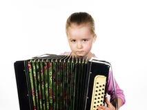 Leuke meisje het spelen harmonika, het concept van het muziekonderwijs royalty-vrije stock afbeelding