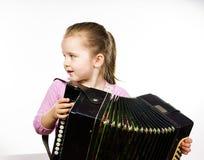 Leuke meisje het spelen harmonika, het concept van het muziekonderwijs stock foto
