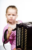 Leuke meisje het spelen harmonika, het concept van het muziekonderwijs stock fotografie