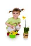 Leuke meisje het water geven bloem Stock Fotografie
