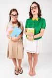 Leuke nerdy meisjes die boeken houden Royalty-vrije Stock Fotografie