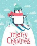 Leuke pinguïn die onderaan de heuvel ski?en Vrolijke Kerstkaart royalty-vrije illustratie