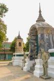 Leuke steen van Chinees kunstenstandbeeld in Wat Suthat Temple, Bangkok, Stock Afbeeldingen