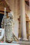 Leuke steen van Chinees kunstenstandbeeld in Wat Suthat Temple, Bangkok, Stock Foto's