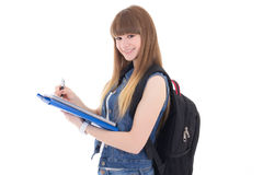 Leuke tiener die die in notitieboekje schrijven op wit wordt geïsoleerd Stock Foto's
