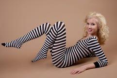 Leuke Tiener in Gestreepte Bodysuit Stock Foto