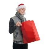 Leuke tienerjongen in grijze sweater over wit geïsoleerde achtergrond Stock Fotografie