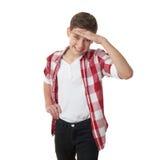Leuke tienerjongen over wit geïsoleerde achtergrond Stock Foto's