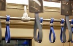 Leuningen in de elektrische trein royalty-vrije stock afbeeldingen