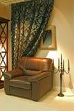 Leunstoel met kaarsen Royalty-vrije Stock Afbeeldingen