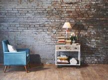 Leunstoel voor bakstenen muur Stock Afbeeldingen