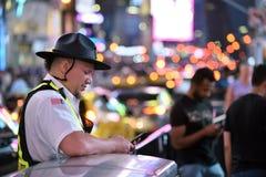 Leute auf dem Times Square in Manhattan Stockbild
