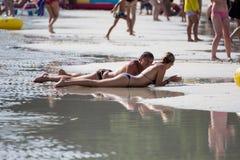 Leute auf Strand Stockfotos