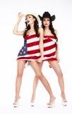 Leute in den Hüten und in Fersen, die in USA-Flagge bedecken Stockbild