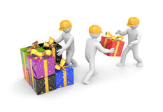 Leute entladen Geschenkboxen Lizenzfreie Stockfotos