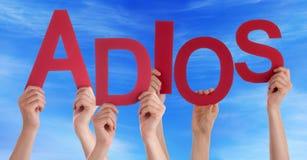 Leute-Griff spanischer Adios bedeutet Auf Wiedersehen blauen Himmel Lizenzfreies Stockfoto