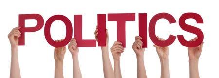Leute-Hände, die rote gerade Wort-Politiken halten Lizenzfreie Stockfotografie