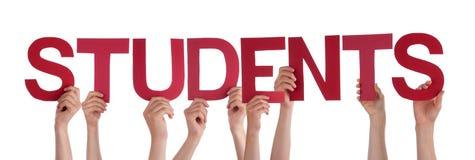 Leute-Hände, die rote gerade Wort-Studenten halten lizenzfreie stockfotos