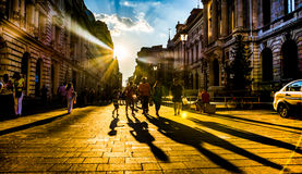 Leute im Sonnenlicht Lizenzfreies Stockfoto