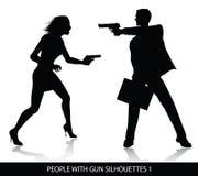 Leute mit Gewehrschattenbildern Lizenzfreie Stockbilder