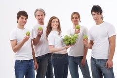 Leute mit grünen Äpfeln Stockfoto