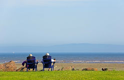 Leute-Strand-Stuhl-Sommer-Szene Lizenzfreies Stockfoto