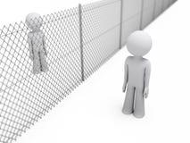 Leute trennten sich durch einen Zaun Lizenzfreies Stockfoto