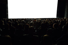 Leute vor Kinoleinwand Stockfotos