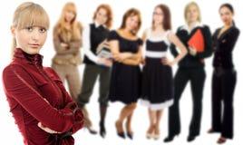 Leutefrauengruppe mit Führer Stockfoto