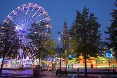 Leuven - Amusement park on Monseigneur Ladeuzeplein - square in evening dusk Stock Photos