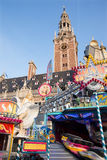 Leuven - Amusement park on Monseigneur Ladeuzeplein - square and tower of University library Stock Images