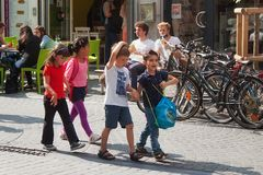 LEUVEN, BELGIUM - SEPTEMBER 05, 2014: Unknown group of the kindergarten children on a walking around the city center in Leuven. The city is the capital of Stock Images