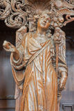 Leuven - Carved angel as symbol of virtuousness of love form St. Michaels church (Michelskerk) Stock Images