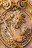 Leuven - Carved relief of Saint John the Baptist in Sint jan de Doperkerk Royalty Free Stock Photography