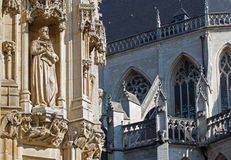 Leuven - Detail of gothic town hall and st. Peters cathedral Stock Images