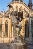 Leuven - Fountain of wisdom or  Fonske is a statue as symbol of students life by sculptor is Jef Claerhout and st. Peters cathed Stock Photography