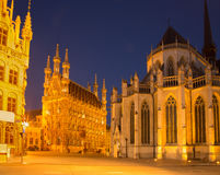 Leuven - Gothic town hall and st. Peters cathedral in evening. Dusk Royalty Free Stock Photography
