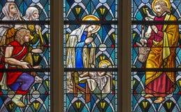 Leuven - julkrubba från fönsterruta i den St Anthony kyrkan från. cent 19. Fotografering för Bildbyråer