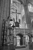 Leuven - Nave of st. Peters gothic cathedral and gothic statue of Madonna Stock Photos